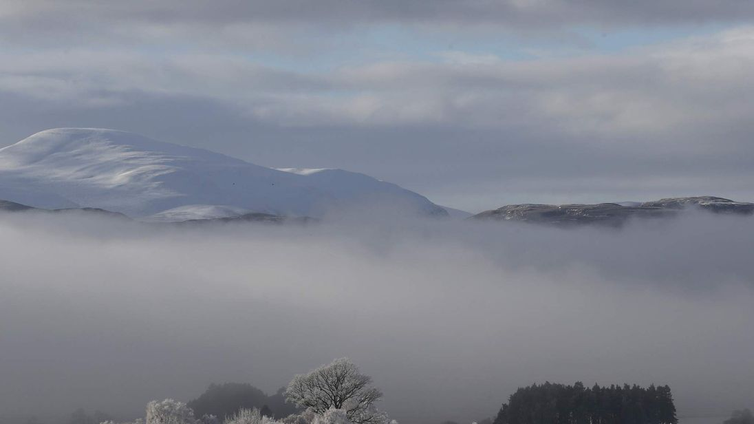 Morning mist sits in the valley of the Spey River near Kincraig Scotland