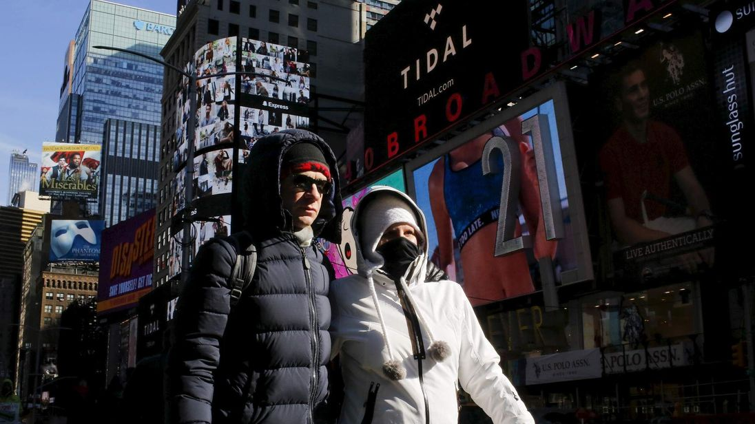People are seen bundled up from the cold in Times Square, NewYork
