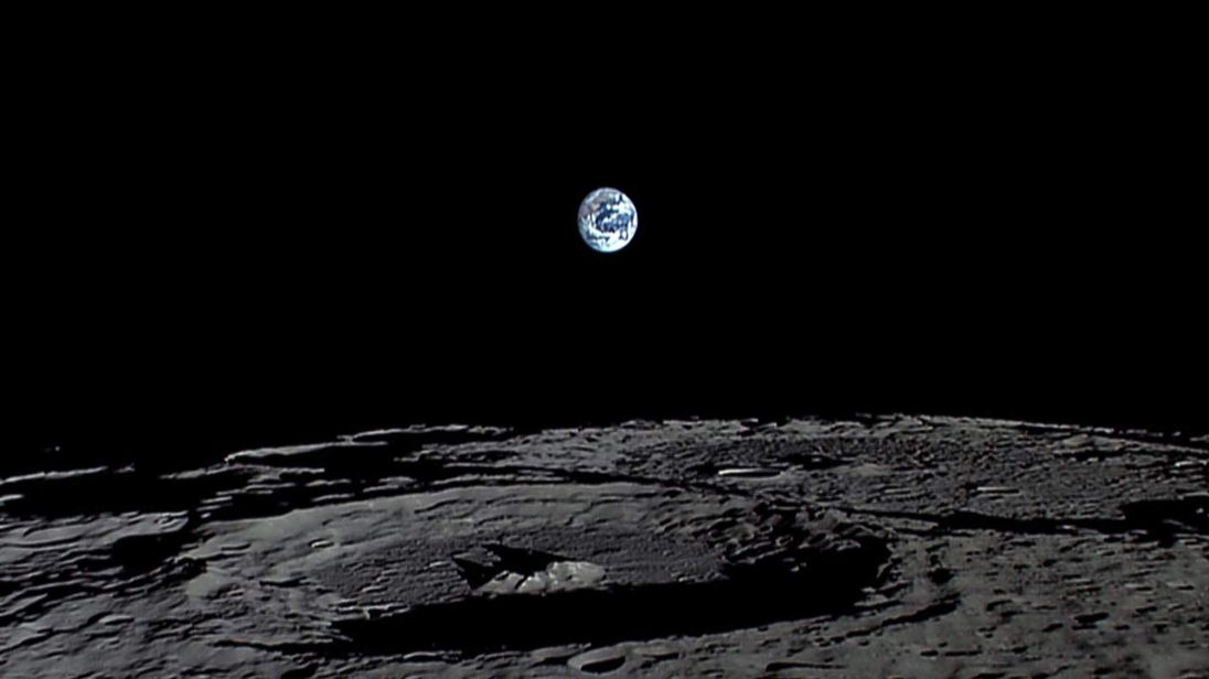 The Earth sets over the Moon's surface in this still from a HDTV video camera onboard Japan's KAGUYA lunar probe