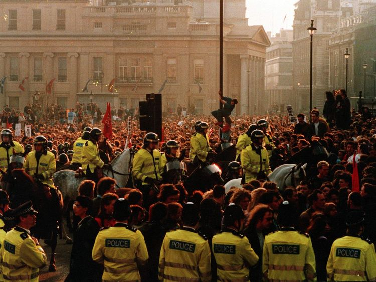 A crowd gathered in Trafalgar Square, London, protesting against the poll tax in 1990