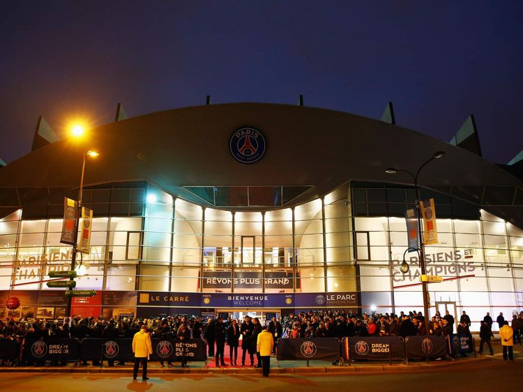 Fans wait outside the stadium prior to the UEFA Champions League Round of 16 match between Paris Saint-Germain and Chelsea at Parc des Princes in Paris.
