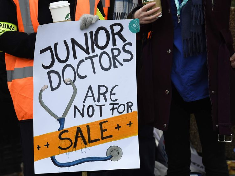 """A placard that reads """"Junior Doctors Are Not For Sale"""" is displayed during a strike outside St Thomas' Hospital in London"""