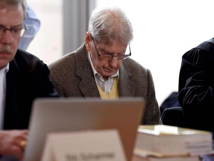 Former Auschwitz guard Reinhold Hanning (C) waits for the start of his trial in Detmold