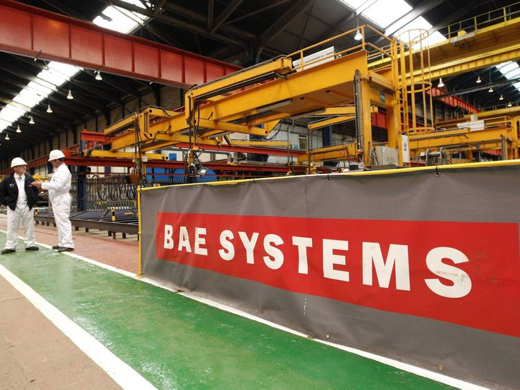 Workmen stand in the BAE Systems' Govan shipyard in Glasgow