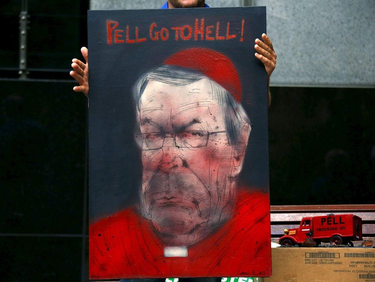 Victims and relatives of children who claim they were sexually abused by the Catholic Church hold placards in Sydney