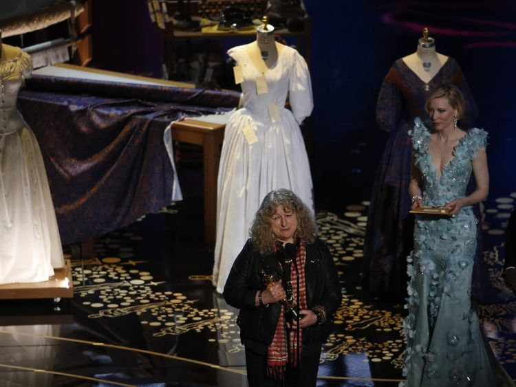 "Beavan accepts the award for Best Costume Design for ""Mad Max: Fury Road"" as presenter Blanchett listens at the 88th Academy Awards in Hollywood"