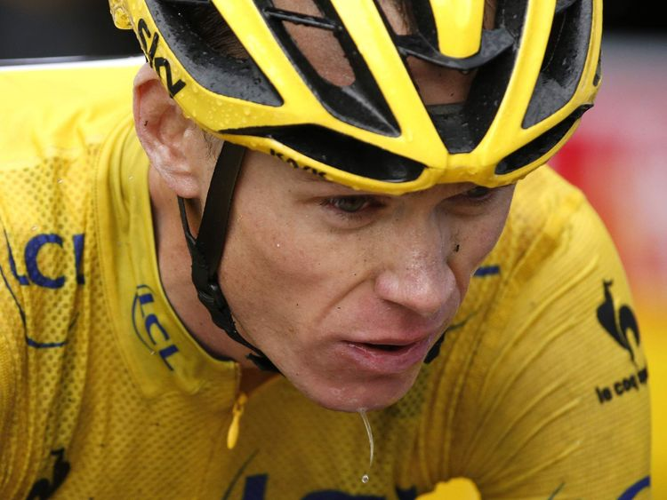 Team Sky rider Froome of Britain, race leader's yellow jersey, crosses the finish line of the 12th stage of the Tour de France cycling race