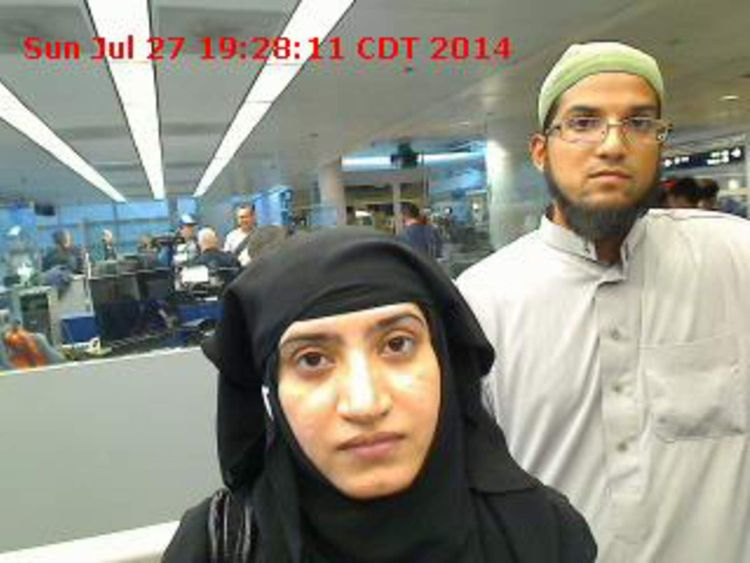 Tashfeen Malik and Syed Farook are pictured passing through Chicago's O'Hare International Airport in this July 27, 2014 handout photo