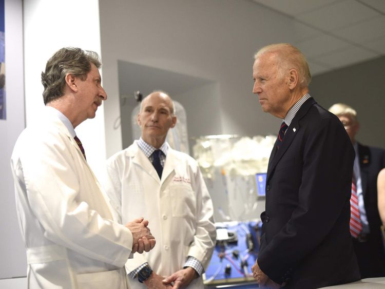 Vice President Joe Biden meets with Dr. Bruce Levine and Dr. Carl June, while touring the University of Pennsylvania, Perelman School of Medicine and Abramson Cancer Center in Philadelphia, Pennsylvania