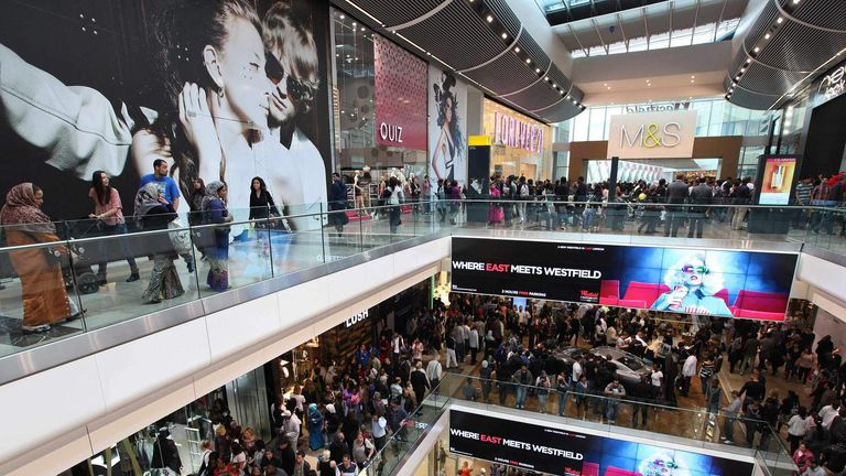 Shoppers crowd the walkways on opening day of the Westfield Stratford City shopping centre in east London