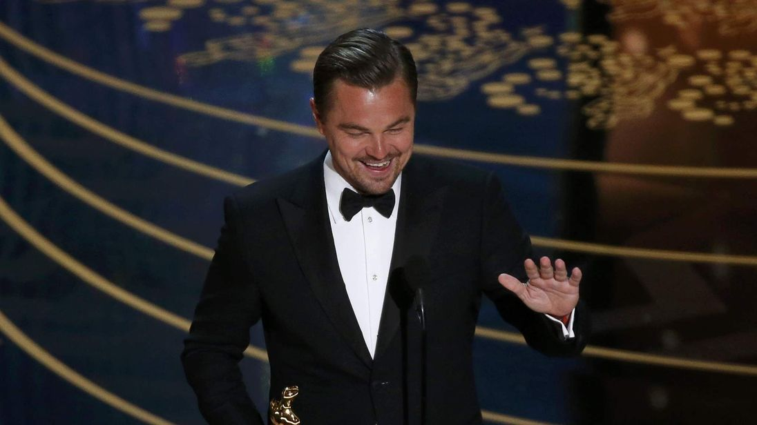 """Leonardo DiCaprio accepts the Oscar for Best Actor for the movie """"The Revenant"""" at the 88th Academy Awards in Hollywood"""