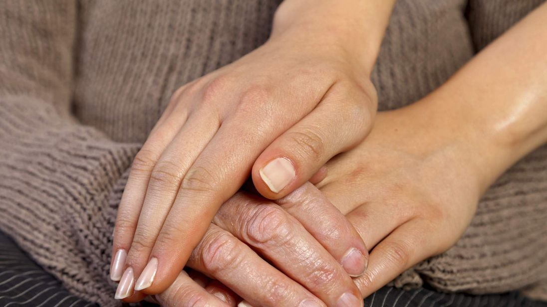 Young hands, holding the hand of an older person