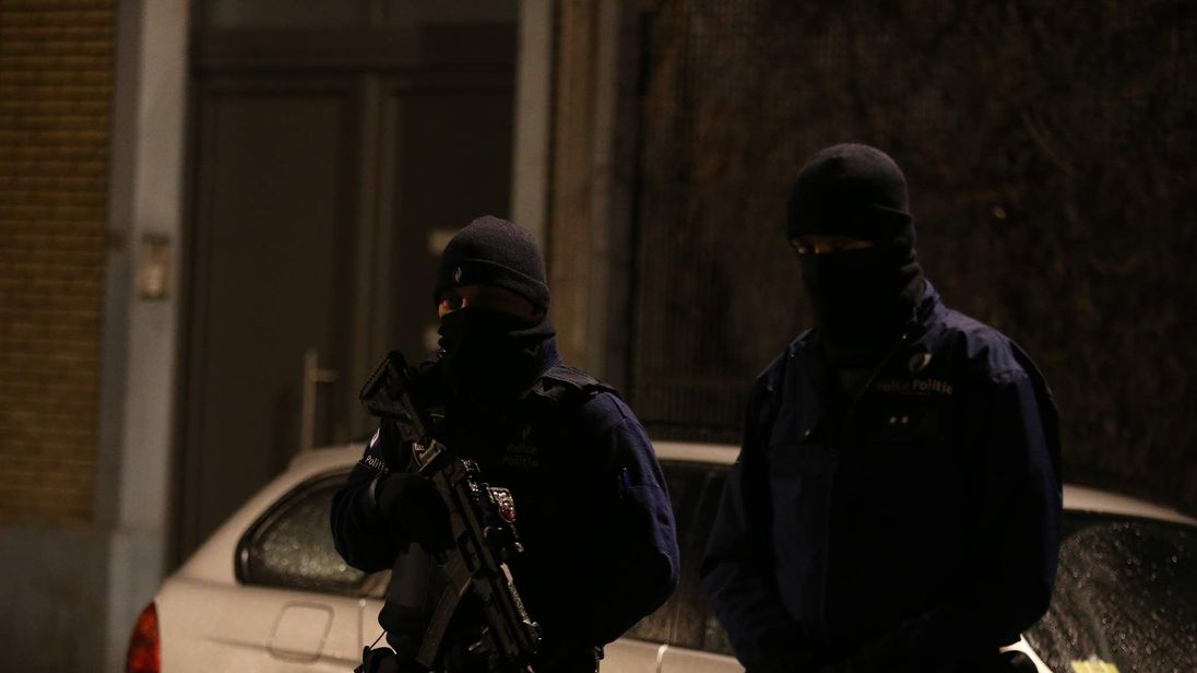 Police officers take part in an operation in Schaerbeek