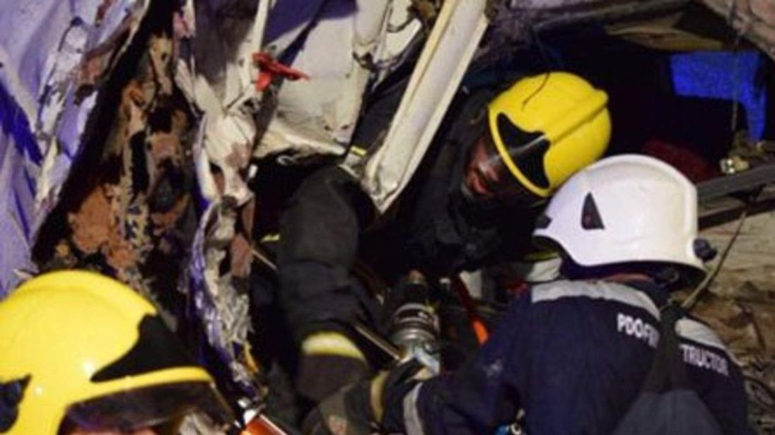 Rescuers working inside the bus