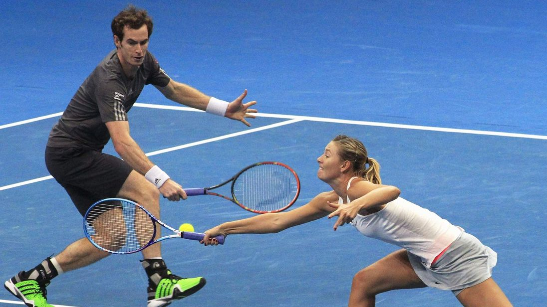 Sharapova and Murray of the Manila Mavericks hit a return to Mladenovic and Zimonjic of the UAE Royals during their mixed doubles tennis match at the IPTL competition in Manila