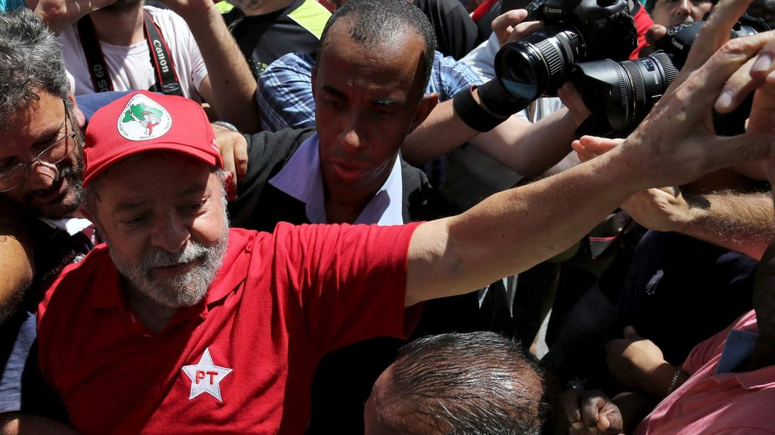 Former Brazilian President Luiz Inacio Lula da Silva is greeted by supporters in front of his home in Sao Bernardo do Camopo