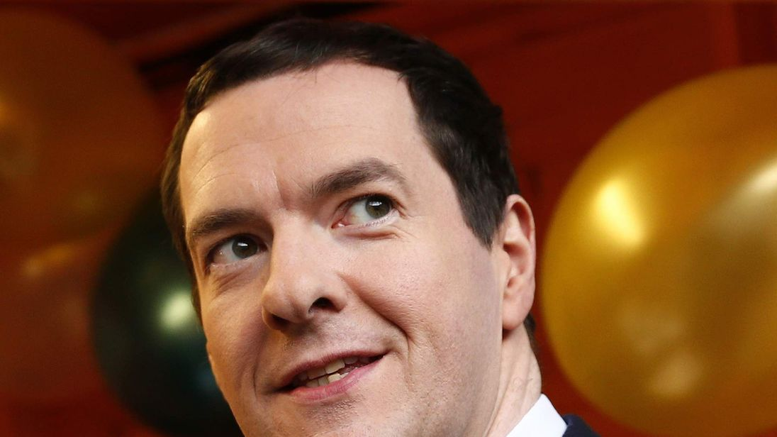 Britain's Chancellor of the Exchequer Osborne looks up during a tour of Small Business Saturday Christmas Fair at the Treasury in London