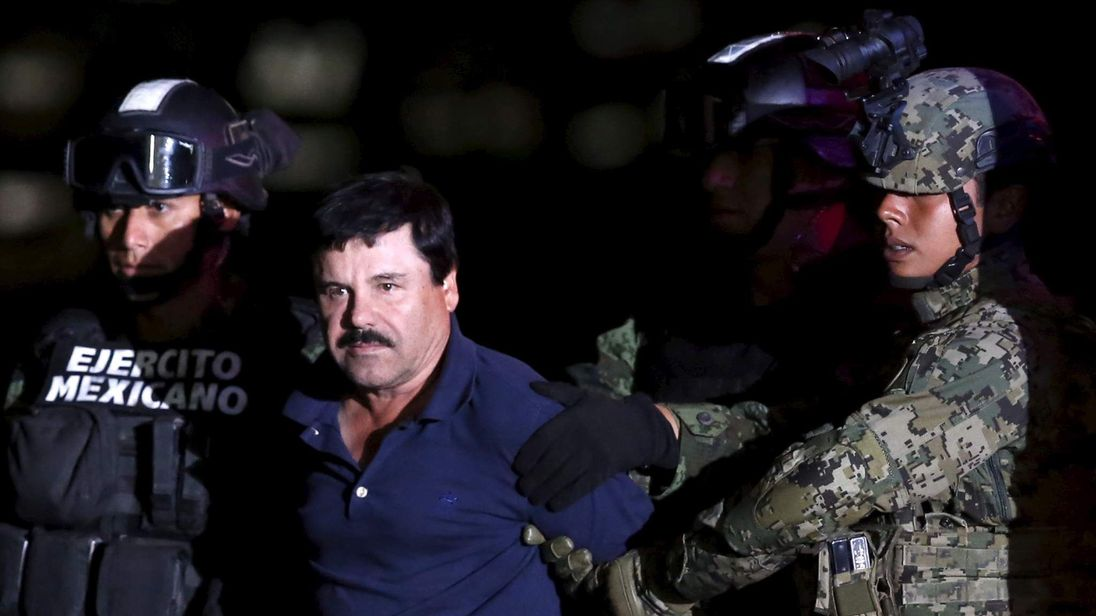 """Joaquin """"El Chapo"""" Guzman is escorted by soldiers during a presentation at the hangar belonging to the office of the Attorney General in Mexico City"""