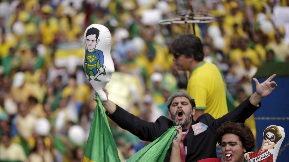 Demonstrators depicting Brazil's former President Lula da Silva and Brazil's President Rousseff attend a protest against Rousseff, part of nationwide protests calling for her impeachment, in Brasilia,