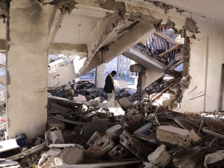 Yemen - Sadiq Rubeid inspects the ruins of his family's home