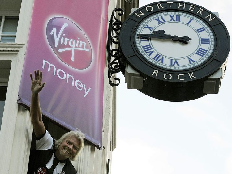 Richard Branson poses in a Newcastle United football jersey during a media conference as Virgin Money take over Northern Rock in Newcastle