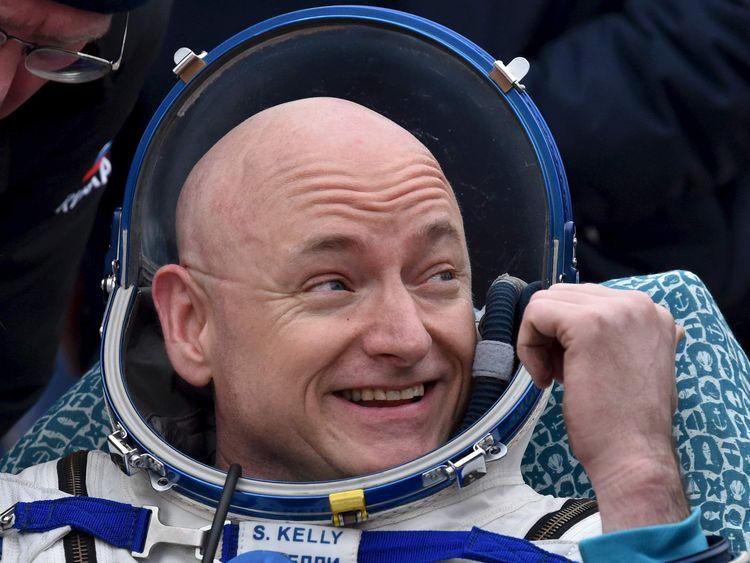U.S. astronaut Scott Kelly reacts shortly after landing near the town of Dzhezkazgan