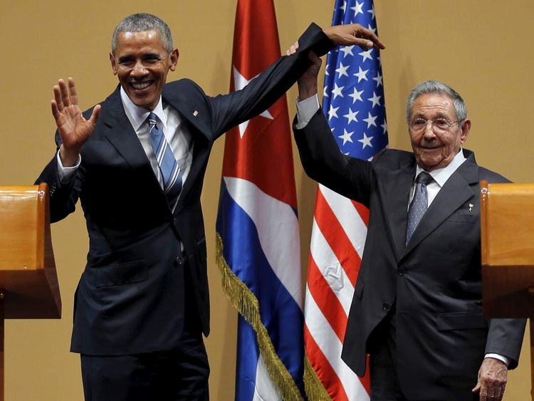 U.S. President Barack Obama and Cuban President Raul Castro gesture after a news conference as part of Obama's three-day visit to Cuba, in Havana