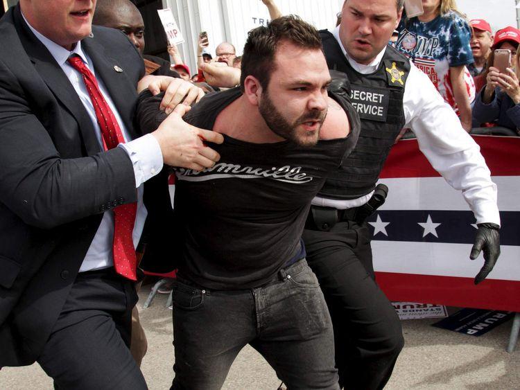 U.S. Secret Service agents detain a man after a disturbance as U.S. Republican presidential candidate Donald Trump spoke at Dayton International Airport in Dayton, Ohio