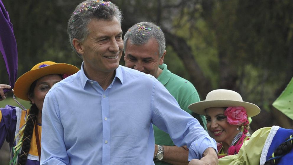Argentina's President Macri dances as he takes part in a carnival celebration in the Argentine northern town of Purmamarca