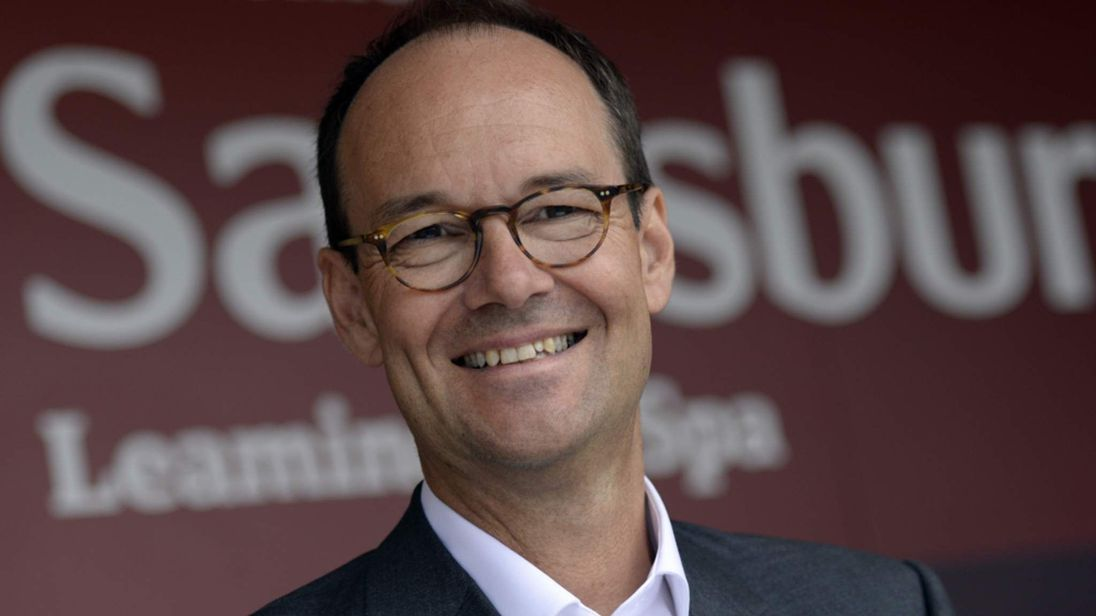 Mike Coupe with Sainsbury's logo