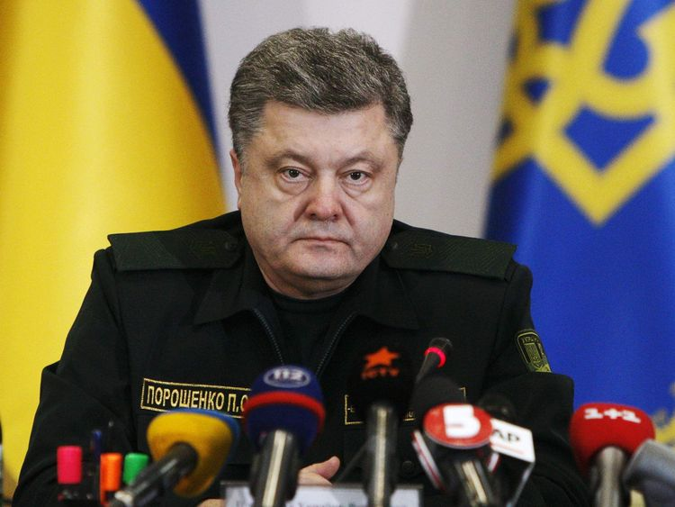 Ukraine's President Petro Poroshenko talks to military staff in Kiev