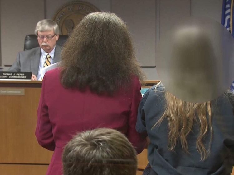 The two 12-year-olds stand in court as the evidence is presented