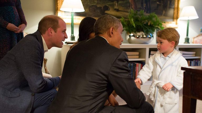 President of the United States Barack Obama (centre) and  First Lady Michelle Obama (behind) at Kensington Palace, London, with the Duke of Cambridge and Prince George