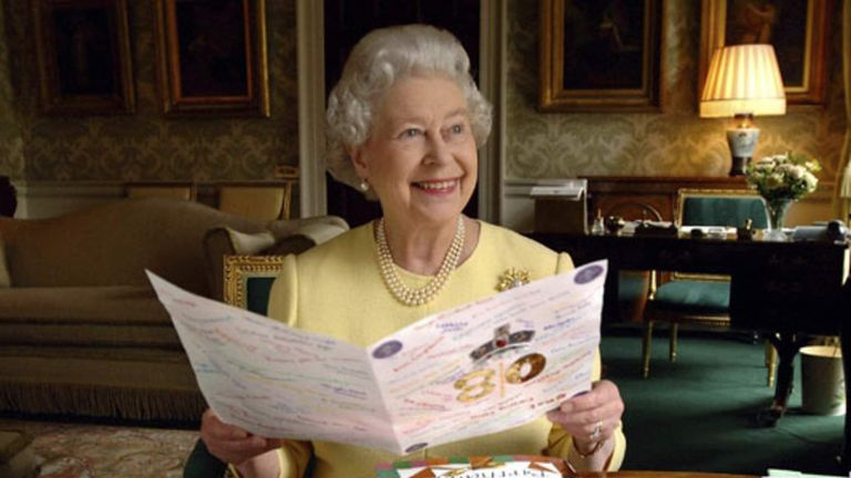 Queen seated in the Regency Room at Buckingham Palace with some of the cards sent to her for her 80th birthday, 21 April 2006
