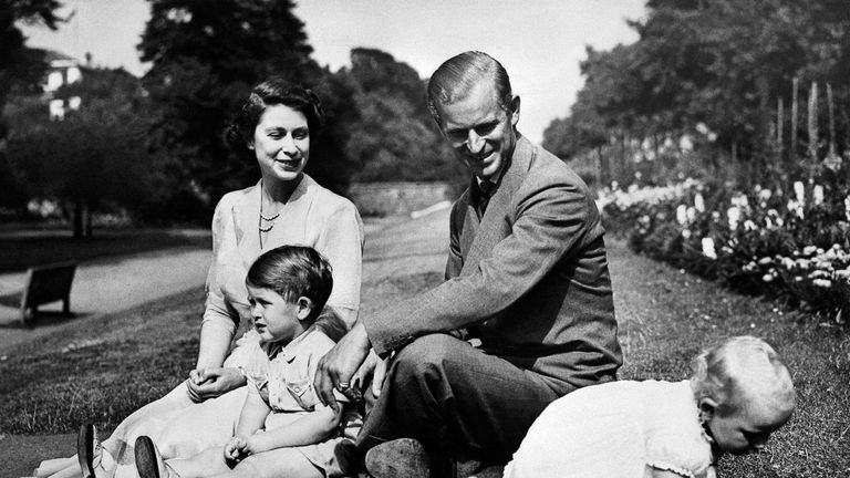 Princess Elizabeth and the Duke of Edinburgh with the first two of their children, Charles (L) and Princess Anne in 1951