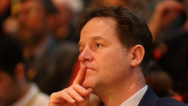 Former Liberal Democrat leader Nick Clegg listens to a speaker during the Liberal Democrats spring conference.