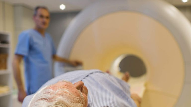 Senior patient about to receive an MRI scan.