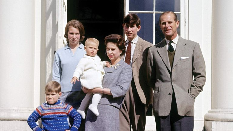 Queen Elizabeth II holding Prince Edward and surrounded by her family, (L-R) the Duke of Edinburgh, the Prince of Wales and Princess Anne, at Windsor on the occasion of her 39th birthday.