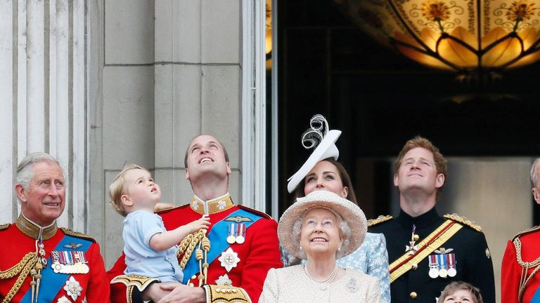 Britain's Camilla the Duchess of Cornwall, Prince Charles, Prince Willian holding Prince George, Catherine, the Duchess of Cambridge, Queen Elizabeth, Prince Harry, and Prince Philip stand on the balcony at Buckingham Palace in central London