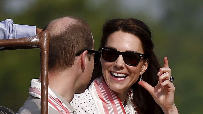 Britain's Catherine, Duchess of Cambridge, shares a moment with her husband Prince William as they sit in a jeep while on a safari at Kaziranga in Assam