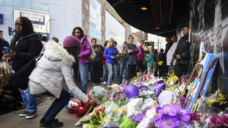 Fans lay flowers and memorials outside First Avenue the nightclub where U.S. music superstar Prince got his start in Minneapolis Minnesota
