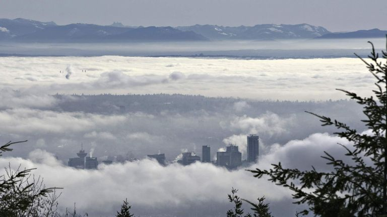 Downtown Vancouver is surrounded by morning fog in this view from Cypress Mountain in West Vancouver