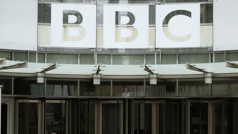 People arrive and depart from Broadcasting House, the headquarters of the BBC in London.