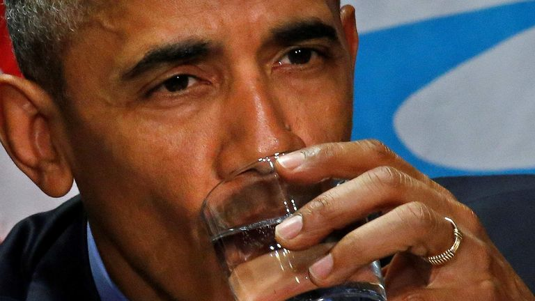 U.S. President Barack Obama drinks a glass of filtered water from Flint, a city struggling with the effects of lead-poisoned drinking water, during a meeting will local and federal authorities in Michigan