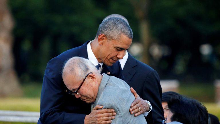 U.S. President Barack Obama hugs  atomic bomb survivor Mori as he visits Hiroshima Peace Memorial Park in Hiroshima, Japan