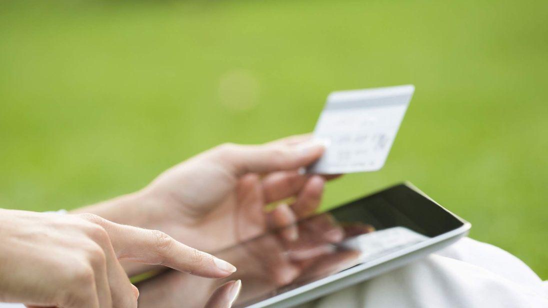 Shopper Uses Tablet For Online Shopping