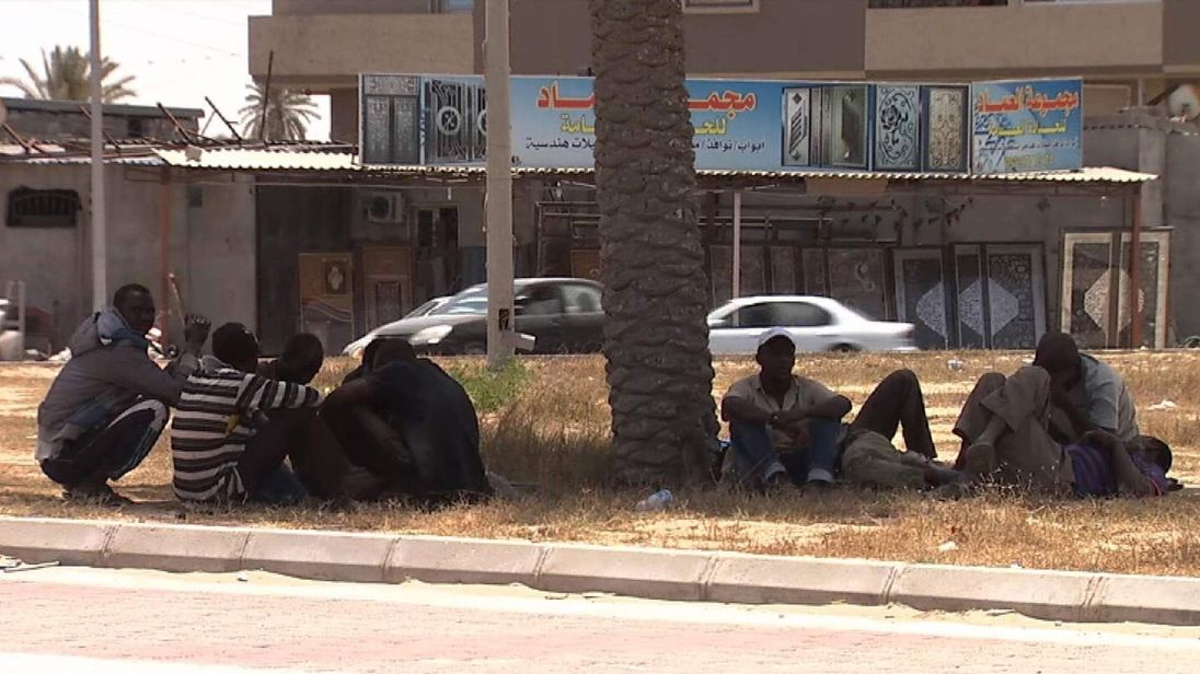 Migrants in Libya waiting by the roadside for work