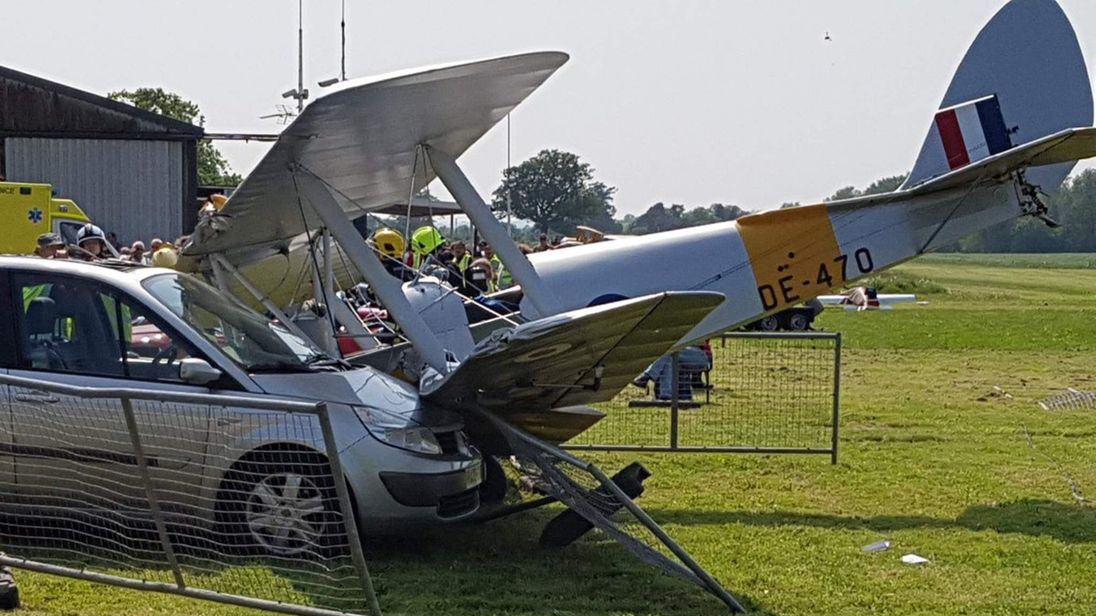 Plane collides with car