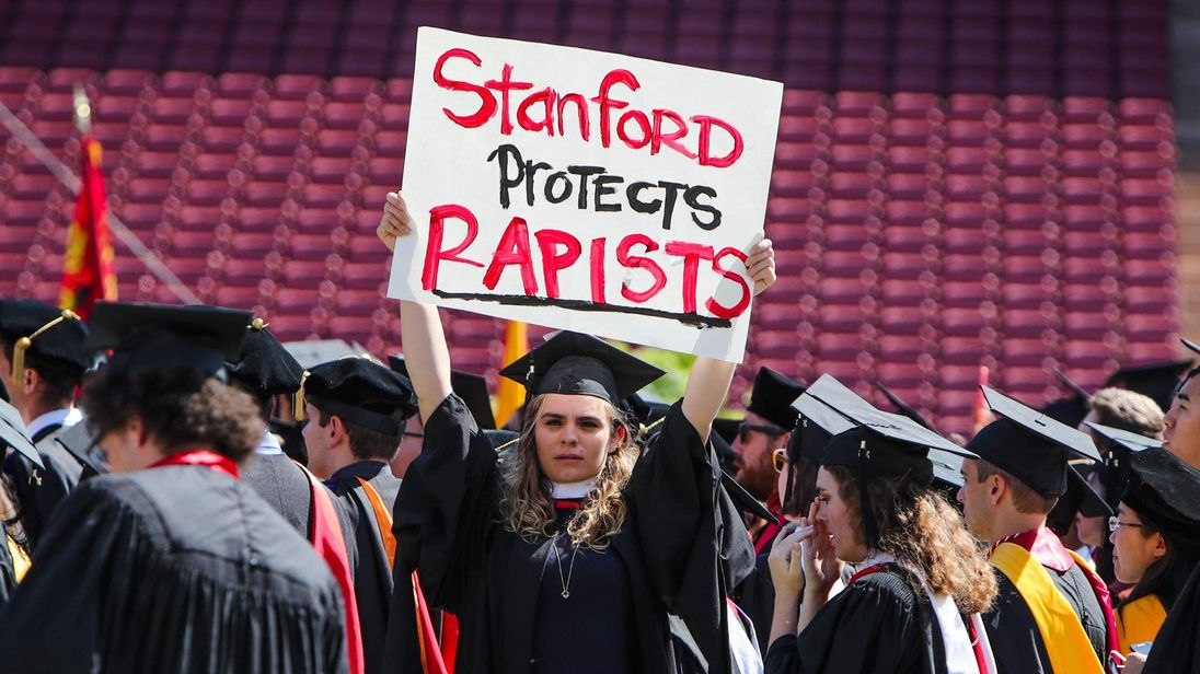 A woman carries a sign in solidarity for a Stanford rape victim