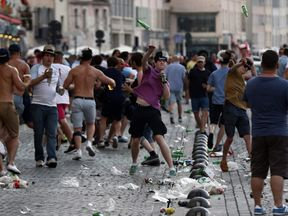 England fans throw bottles at police in Marseille